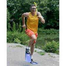 man running in snorkel gear